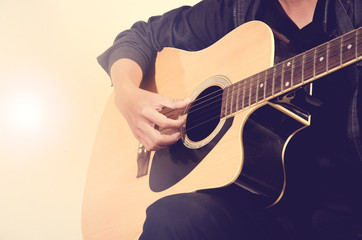 Acoustic guitar,Man's guitarist playing details. Musical instrument with performer hands
