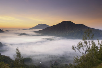 Foggy day at Pinggan village during sunrise. View from Pinggan Hill.