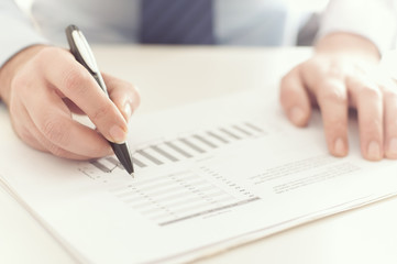 Businessman checking a business report