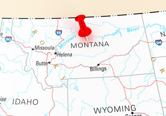 Red Thumbtack Over Montana State USA Map