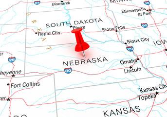 Red Thumbtack Over Nebraska State USA Map