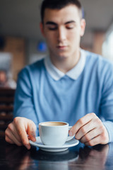 Young man in a cafe