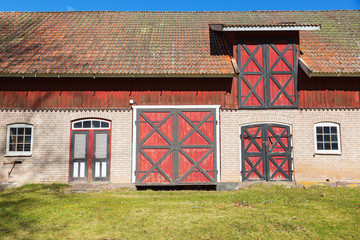 Wall Mural - Rustic barn with colorful doors