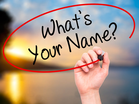 Man Hand writing What's your Name? with black marker on visual s
