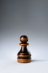 Black pawn on a white table