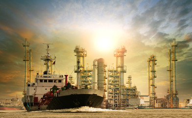 petroleum lpg gas container ship and oil refinery plant industry estate behind use for petrochemical industrial topic