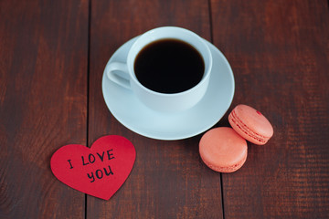 valentine macaroons with coffee on wooden table.I love you.Valen