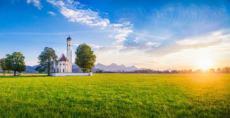 St. Coloman Church at sunset, Bavaria, Germany Wall mural