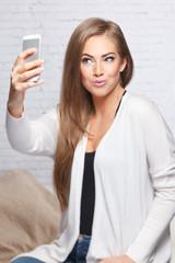 Pretty woman taking a selfie