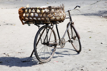Old rusty bicycle with a basket