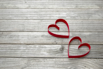 Two hearts on a wood background