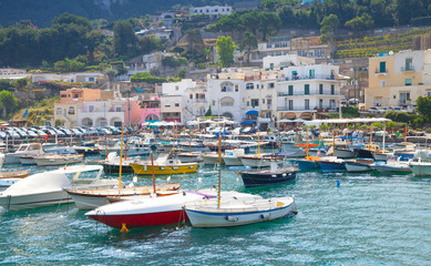 Capri island, Italy. Colorful houses and motorboats
