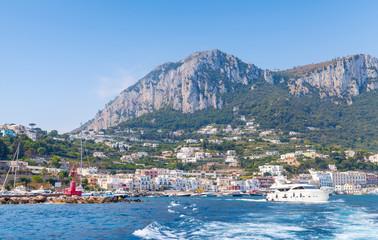Port of Capri, Italy. Pleasure boats go near breakwater