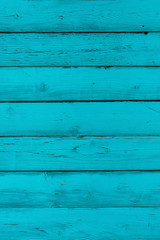 Natural wooden blue, turquoise boards, wall or fence with knots. Painted wooden horizontal planks. Abstract textured background, empty template