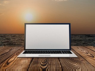 Laptop on sea background