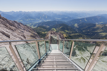 Steps to a hanging lookout of alpine landscape seen from Dachste