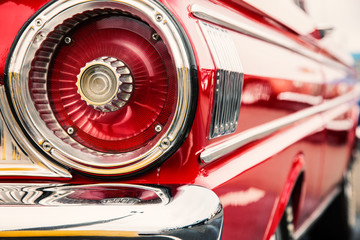 Fotomurales - Photograph of classic car with close-up on taillights