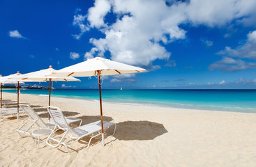 Chairs and umbrellas on tropical beach