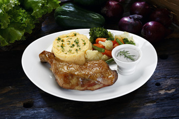 chicken leg roast with mashed potatoes with vegetables
