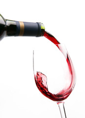 Red Wine Splashes into Stemmed Serving Glass
