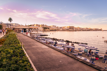 Wall Mural - Sunset on the seafront at Otranto in southern Italy.