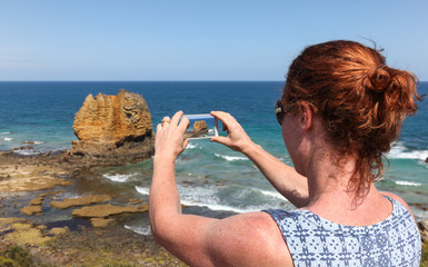 Great Ocean Road Tourist Taking Phone Photo