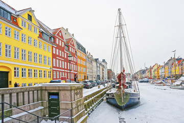 Colored facades of Nyhavn in Copenhagen in Denmark in winter