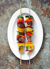Various vegetables and meat kebabs
