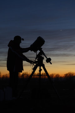 Amateur astronomer with his telescope