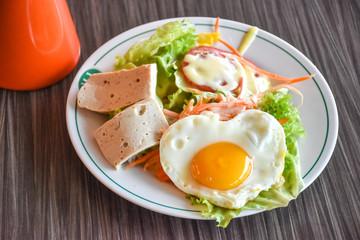 Close up breakfast salad ham and eggs on table wood/Food of Love