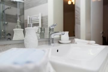 Sink, Tap, Towels and Bathroom Set. Modern Bathroom Interior Des