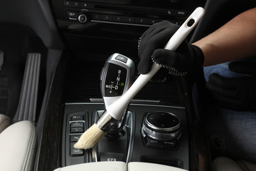 Car service. Cleaning of  interior by a brush