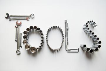 Слово выложенное из инструментов