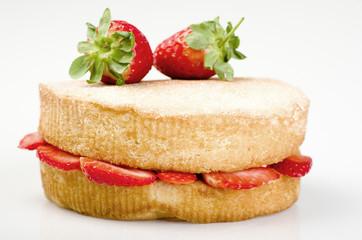 Victoria sponge cake with fresh strawberries on white background