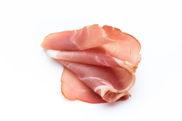 Slices of ham on white background.