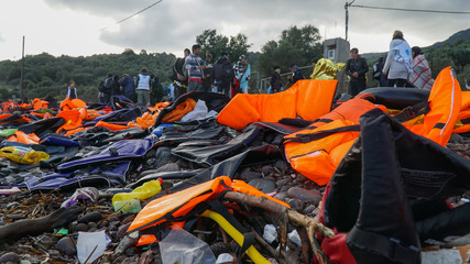 Abandoned belongings and life jackets on the Lesvos shore