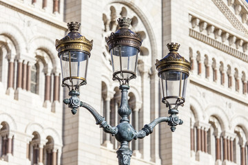 MONTE-CARLO, MONACO, on JANUARY 10, 2016. An ancient streetlight against of a cathedral (Saint Nikolay's Cathedral)