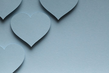 Blue hearts on blue background
