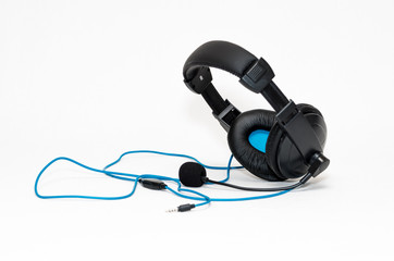 Headphones with a microphone and wire jack isolated on white bac