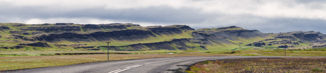 panorama with road and mountains hills in Iceland