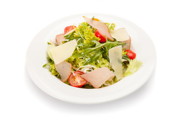 Vegetable salad with ham, parmesan cheese and cherry tomatoes.