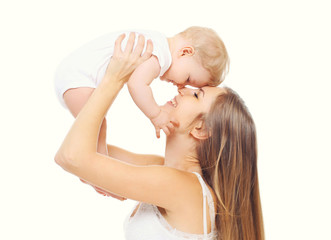 Happy smiling mother with baby having fun together on white back