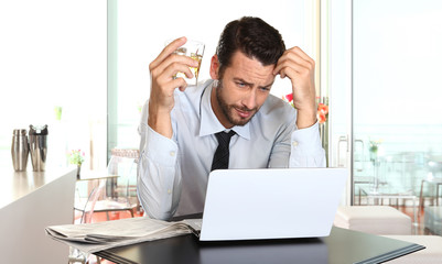 worried and tired businessman in crisis working on computer laptop