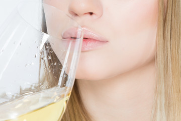 Close uo of young woman  who is drinking wine