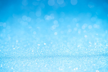 Blue glitter surface with blue light bokeh