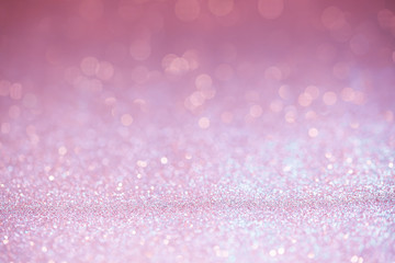 Pink glitter surface with pink light bokeh