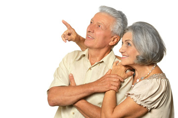 Elderly couple pointing