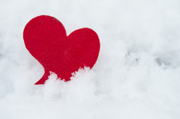 red heart on ice wet snow,  outdoors image