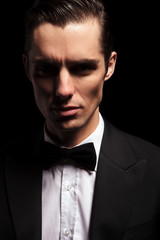 dark portrait of classy man in tuxedo with bowtie