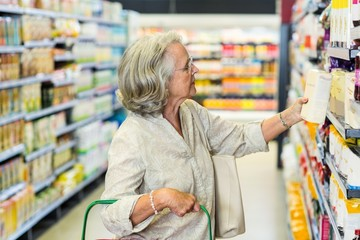 Senior woman buying food